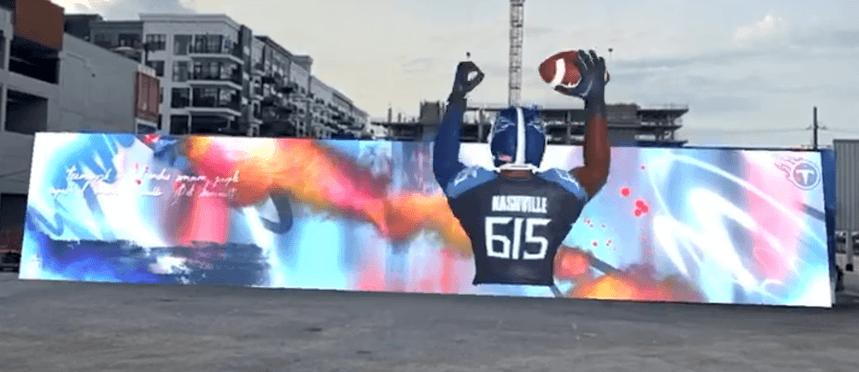 Creative Sample #7: Football team's mural as seen through a phone using WebAR